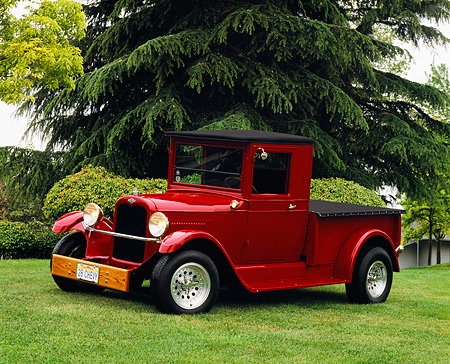 AUT 14 RK0680 01 © Kimball Stock 1928 Chevy Pick Up Truck Burgundy 3/4 Side View On Grass By Trees