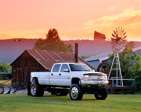 AUT 14 RK0706 04 © Kimball Stock 2002 Chevrolet 3500 Duramax Diesel White 3/4 Front View On Grass By Barn Filtered