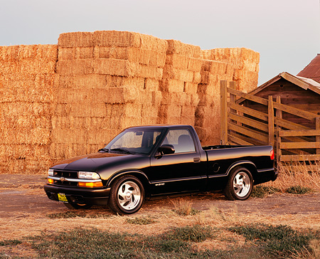AUT 14 RK0748 03 © Kimball Stock 2002 Chevy S10 Black Pick Up Truck 3/4 Side View By Hay Stacks