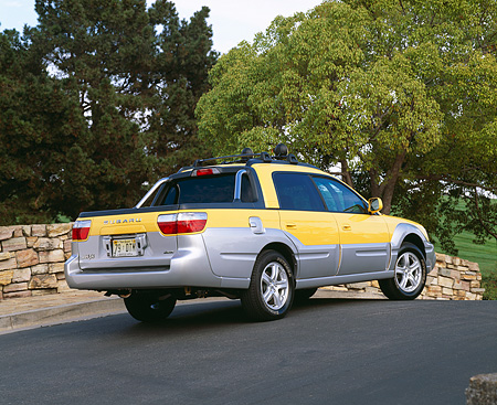AUT 14 RK0796 01 © Kimball Stock 2003 Suburu Baja 4WD Yellow Rear 3/4 View On Pavement By Trees