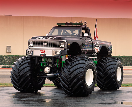 AUT 14 RK0825 31 © Kimball Stock 1972 Chevrolet Monster Truck Skoal Bandit Black Front 3/4 Front View On Wet Pavement