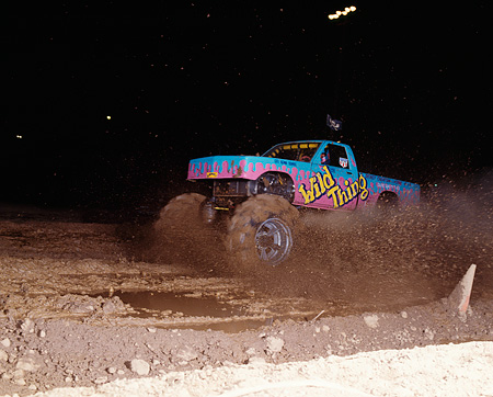 AUT 14 RK0832 18 © Kimball Stock Wild Thing Monster Truck Driving Through Mud At Night