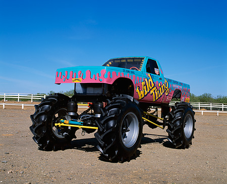 AUT 14 RK0836 15 © Kimball Stock Monster Truck Wild Thing Side 3/4 View On Dirt Blue Sky