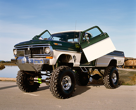 AUT 14 RK0841 13 © Kimball Stock 1970 Ford F250 4x4 Gullwing Monster Truck 3/4 Front View Doors Open On Pavement