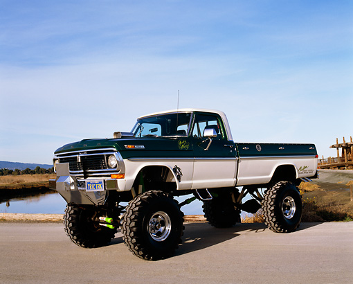 AUT 14 RK0843 05 © Kimball Stock 1970 Ford F250 4x4 Monster Truck 3/4 Front View On Pavement By Water
