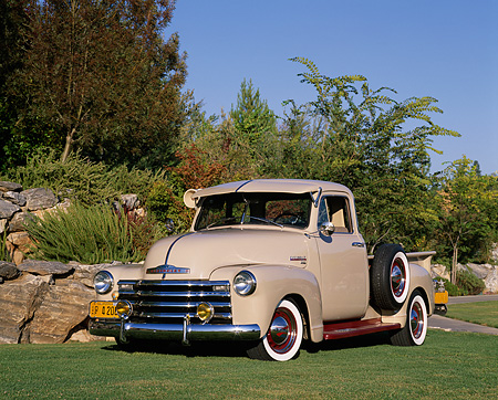 AUT 14 RK0952 01 © Kimball Stock 1949 Chevy Pick Up Truck Tan 3/4 Front View On Grass By Bushes