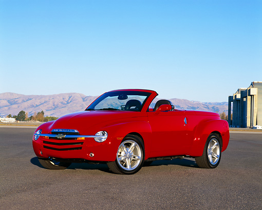 AUT 14 RK0955 01 © Kimball Stock 2003 Chevrolet SSR Convertible Red 3/4 Front View On Pavement Blue Sky