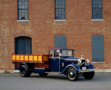 AUT 14 RK0976 02 © Kimball Stock 1921 Hispano Suiza Truck Blue 3/4 Front View On Pavement By Brick Building