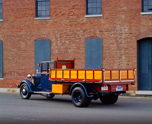 AUT 14 RK0977 01 © Kimball Stock 1921 Hispano Suiza Truck Blue 3/4 Rear View On Pavement By Brick Building