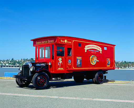 AUT 14 RK0982 07 © Kimball Stock 1927 Circus Truck 3/4 Side View On Pavement By Water