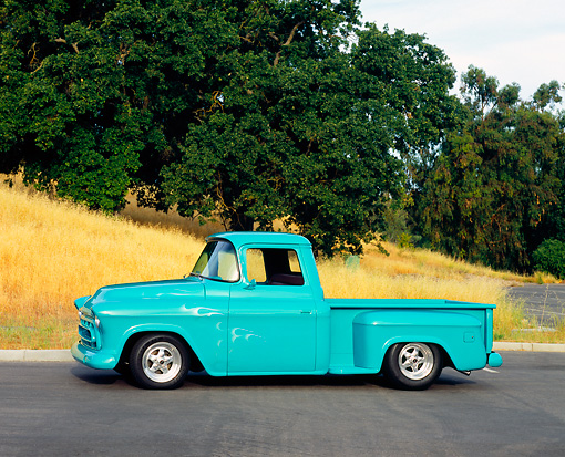 AUT 14 RK1008 01 © Kimball Stock 1957 Chevrolet Pick Up Truck Turquoise 3/4 Front View On Pavement By Trees