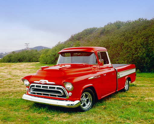 AUT 14 RK1048 03 © Kimball Stock 1957 Chevrolet Cameo Red And White 3/4 Front View On Grass By Mountain