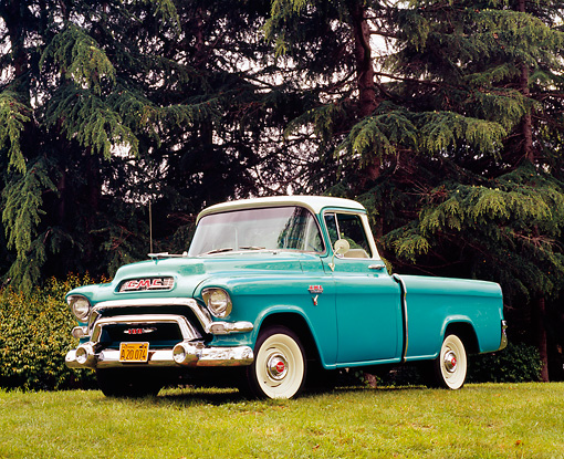 AUT 14 RK1071 02 © Kimball Stock 1956 GMC Suburban Pickup Truck Green And White 3/4 Front View On Grass Trees Background