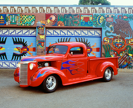 AUT 14 RK1082 07 © Kimball Stock 1940 Chevy 1/2 Ton Pick Up Truck Red With Flames 3/4 Side View On Pavement By Artwork