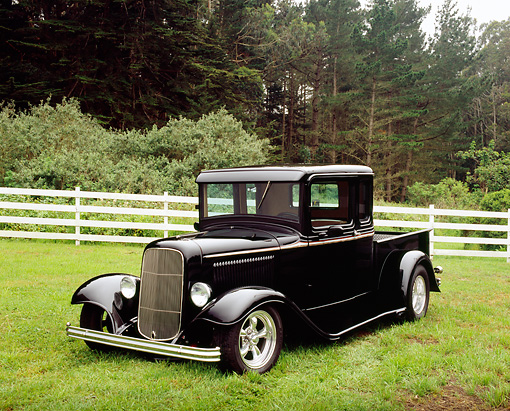 AUT 14 RK1085 01 © Kimball Stock 1934 Ford Pickup Truck Black 3/4 Front View On Grass By Fence