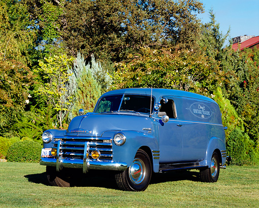 AUT 14 RK1105 02 © Kimball Stock 1950 Chevy Panel 1 Ton Truck Blue 3/4 Front View On Grass By Trees