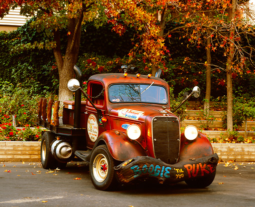 AUT 14 RK1112 01 © Kimball Stock 1937 Ford, Flat Bed Pick Up Truck Red 3/4 Front View On Pavement By Trees