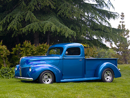 AUT 14 RK1135 01 © Kimball Stock 1940 Ford Pick Up Truck Teal 3/4 Side View On Grass By Trees