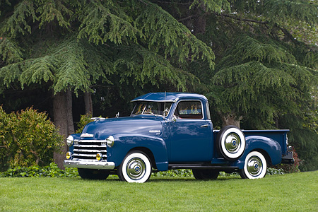 AUT 14 RK1153 01 © Kimball Stock 1950 Chevrolet 3100 Pick Up Truck Blue 3/4 Side View On Grass By Trees
