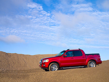 AUT 14 RK1179 01 © Kimball Stock 2007 Ford Explorer Sport Trac Pick Up Truck Red 3/4 Front View On Sand Hill