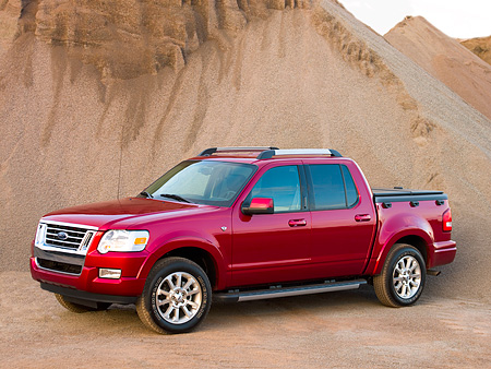 AUT 14 RK1181 01 © Kimball Stock 2007 Ford Explorer Sport Trac Pick Up Truck Red 3/4 Side View On Sand