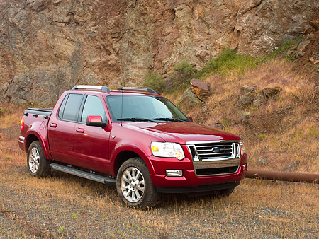 AUT 14 RK1182 01 © Kimball Stock 2007 Ford Explorer Sport Trac Pick Up Truck Red 3/4 Front View On Gravel