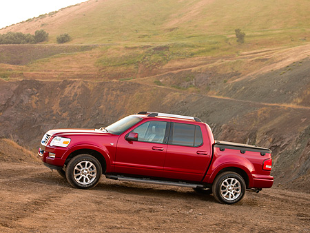 AUT 14 RK1191 01 © Kimball Stock 2007 Ford Explorer Sport Trac Limited Pick Up Truck Red 3/4 Front View On Dirt Hill