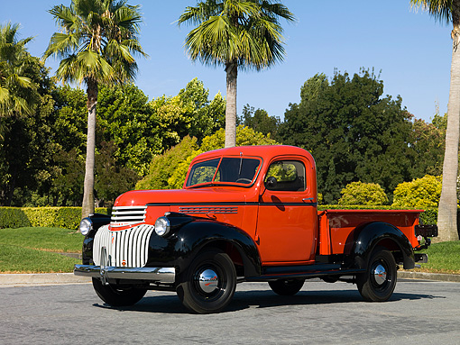 AUT 14 RK1202 01 © Kimball Stock 1946 Chevrolet CK 1/2 Ton Red And Black Pick Up Truck Side 3/4 View On Pavement