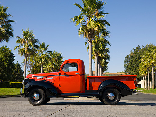 AUT 14 RK1204 01 © Kimball Stock 1946 Chevrolet CK 1/2 Ton Red And Black Pick Up Truck Profile View On Pavement