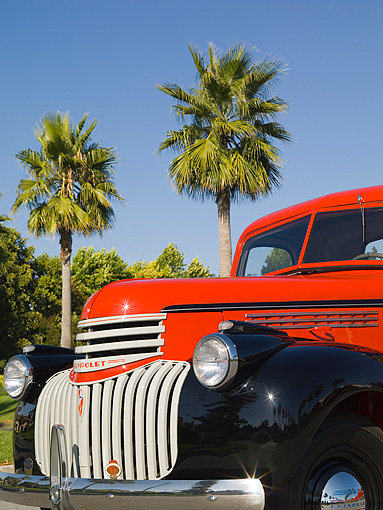 AUT 14 RK1205 01 © Kimball Stock 1946 Chevrolet CK 1/2 Ton Red And Black Pick Up Truck 3/4 Front View Detail By Palm Trees