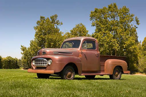 AUT 14 RK1210 01 © Kimball Stock 1948 Ford F1 Unrestored Red Pick Up Truck Low 3/4 Side View On Grass