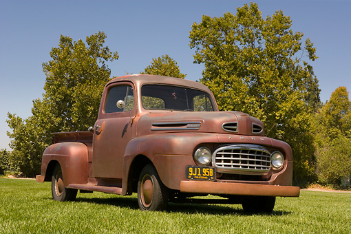 AUT 14 RK1211 01 © Kimball Stock 1948 Ford F1 Unrestored Red Pick Up Truck Low 3/4 Front View On Grass