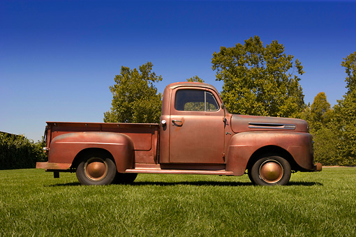 AUT 14 RK1212 01 © Kimball Stock 1948 Ford F1 Unrestored Red Pick Up Truck Profile View On Grass