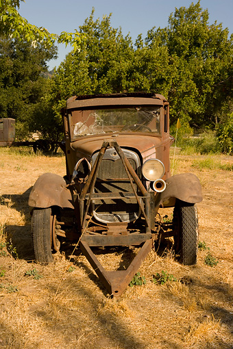 AUT 14 RK1213 01 © Kimball Stock Abandoned Rusty Truck Head On In Dry Grass Field