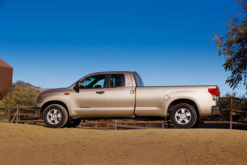 AUT 14 RK1234 01 © Kimball Stock 2007 Toyota Tundra Double Cab SR5 Long Bed Sand Mica Low Profile View On Dirt