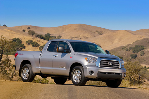 AUT 14 RK1235 01 © Kimball Stock 2007 Toyota Tundra Double Cab Limited TRD Slate 3/4 Side View On Pavement By Hills