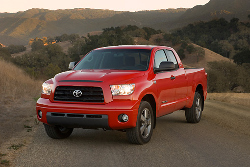AUT 14 RK1253 01 © Kimball Stock 2007 Toyota Tundra Double Cab SR5 Red 3/4 Front View On Pavement By Hills At Dusk