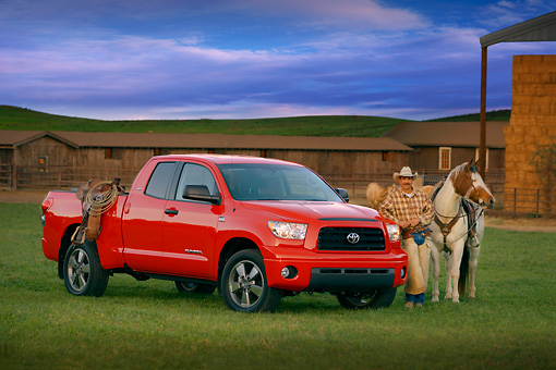 AUT 14 RK1268 05 © Kimball Stock 2007 Toyota Tundra Double Cab SR5 Red 3/4 Side View On Grass By Wrangler And Horse
