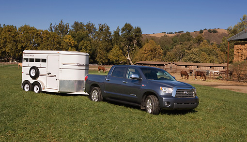 AUT 14 RK1285 01 © Kimball Stock 2007 Toyota Tundra Crewmax Blue Metallic 3/4 Front View On Grass With Trailer