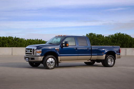 AUT 14 RK1286 01 © Kimball Stock 2008 Ford F-450 Super Duty King Ranch Blue And Silver Low 3/4 Side View On Pavement Blue Sky