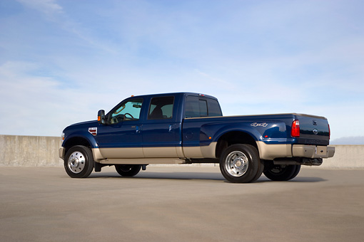AUT 14 RK1289 01 © Kimball Stock 2008 Ford F-450 Super Duty King Ranch Blue And Silver Low 3/4 Rear View On Pavement