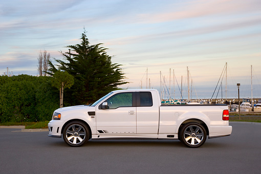 AUT 14 RK1295 01 © Kimball Stock 2007 Saleen S331 Supercharged Sport Truck White Low Profile View On Pavement