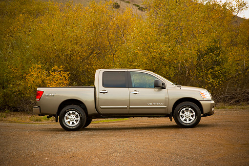 AUT 14 RK1300 01 © Kimball Stock 2007 Nissan Titan 4x4 SE Gray Low Profile On Pavement By Trees