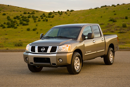 AUT 14 RK1302 01 © Kimball Stock 2007 Nissan Titan 4x4 SE Gray 3/4 Front View On Pavement By Hills
