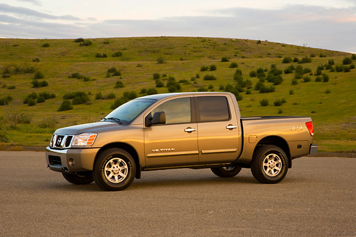 AUT 14 RK1303 01 © Kimball Stock 2007 Nissan Titan 4x4 SE Gray 3/4 Side View On Pavement By Hills