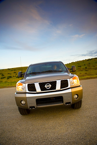 AUT 14 RK1304 01 © Kimball Stock 2007 Nissan Titan 4x4 SE Gray Slanted Head On View On Pavement By Hills