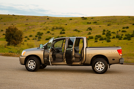 AUT 14 RK1305 01 © Kimball Stock 2007 Nissan Titan 4x4 SE Gray Profile View On Pavement Doors Open By Hills