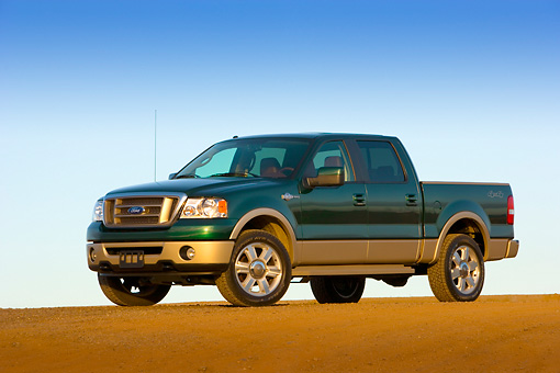 AUT 14 RK1306 01 © Kimball Stock 2007 Ford F-150 King Ranch Lariat Green Low 3/4 Side View On Pavement