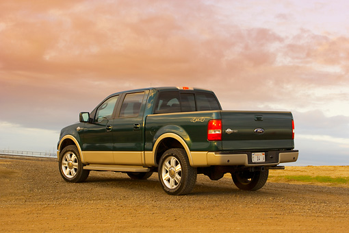 AUT 14 RK1309 01 © Kimball Stock 2007 Ford F-150 King Ranch Lariat Green 3/4 Rear View On Pavement