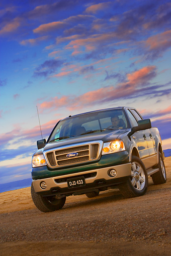 AUT 14 RK1311 01 © Kimball Stock 2007 Ford F-150 King Ranch Lariat Green 3/4 Low Front View On Pavement